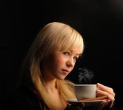 Young  woman with coffe  on a dark background Stock Photos