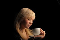 Young  woman with coffe  on a dark background Royalty Free Stock Photos