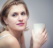 Young woman with coffee Stock Images