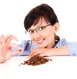 Young woman with coffee beans Stock Photos