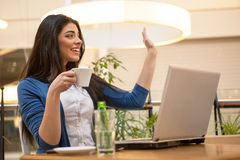 Young woman on coffee break. Young woman in restaurant on coffee break working on lap top Royalty Free Stock Photo