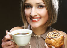 Young woman with coffee and cookies. Stock Images