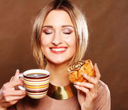 Young woman with coffee and cookies. Stock Photo