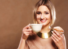 Young woman with coffee and cookies. Stock Image