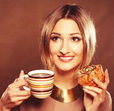 Young woman with coffee and cookies. Royalty Free Stock Photos