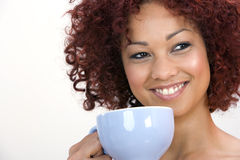 Young woman with coffee cup Royalty Free Stock Images