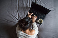 Young woman with coffee and laptop Stock Photo
