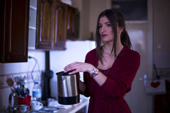 Young woman with coffee maker in the kitchen Royalty Free Stock Photo