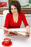 Young woman with coffee and notepad Royalty Free Stock Photo