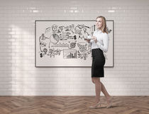Young woman with coffee and project sketch Stock Photography