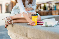 Young woman with coffee to go in the city Royalty Free Stock Photo