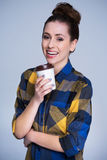 Young woman with coffee to go Royalty Free Stock Image