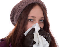Young woman with a cold and flu virus sneezing Royalty Free Stock Photo