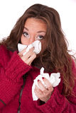Young woman with a cold and handkerchiefs Stock Images