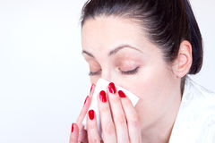Colds. The young woman is cold and holding a handkerchief, photography Stock Photos