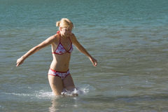 Young woman in a cold lake stock photo