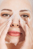Young woman with collagen mask. Stock Photography