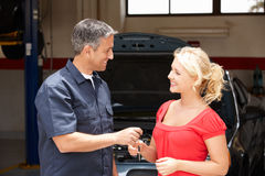 Free Young Woman Collecting Car From Repair Shop Royalty Free Stock Photos - 21042368