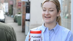 Young Woman Collecting Money For Charity In Street stock video