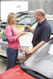Young woman collecting new car Royalty Free Stock Photo