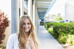 Young woman on college campus Stock Image