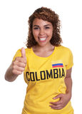 Young woman from Colombia showing thumb Stock Image
