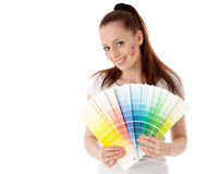 Young woman with a color guide. Royalty Free Stock Photos