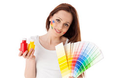 Young woman with a color guide. Royalty Free Stock Image