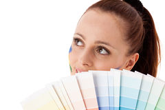 Young woman with a color guide. Royalty Free Stock Images