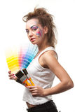 Young woman with a color guide and paintbrushes. Stock Images