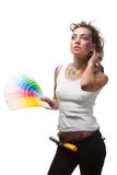 Young woman with a color guide and paintbrushes. Royalty Free Stock Image
