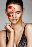 Young woman with color patches on her face screwed up her eyes. stock images