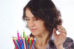 Young woman with color pencils Royalty Free Stock Photos