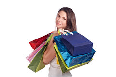 Young woman with colored bags Royalty Free Stock Photography