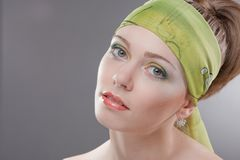 young woman in colored scarf on head Royalty Free Stock Photo