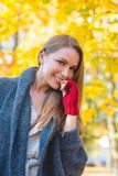 Young woman in a colorful autumn garden Royalty Free Stock Photos