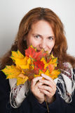 Young woman with colorful autumn maple leaves Stock Images
