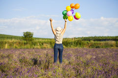 Young woman with colorful ballons Stock Photos