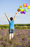 Young woman with colorful ballons on the lavander field Stock Images