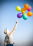 Young woman with colorful ballons on the lavander field Stock Image