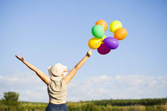 Young woman with colorful ballons Stock Photography