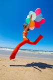 Young woman with colorful balloons Stock Images