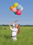 Young woman with colorful balloons Stock Photos