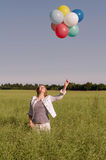 Young woman with colorful balloons Royalty Free Stock Photos