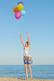 Young woman with colorful balloons Royalty Free Stock Photo