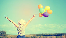 Young woman with colorful balloons Royalty Free Stock Image