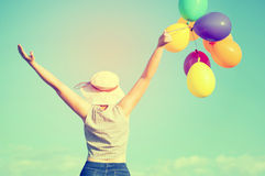 Young woman with colorful balloons Stock Photo