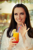 Young Woman with Colorful Cocktail Drink Outside Stock Photography