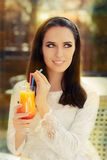 Young Woman with Colorful Cocktail Drink Outside Stock Photos