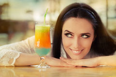 Young Woman with Colorful Cocktail Drink Outside Royalty Free Stock Photos